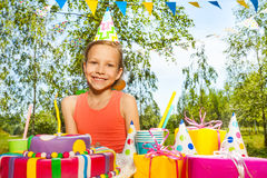 Portrait of happy birthday young girl in party hat Stock Photography