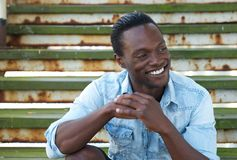 Portrait of a happy black man laughing outdoors Royalty Free Stock Image