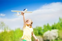 Portrait of happy blond girl holding airplane toy Royalty Free Stock Images