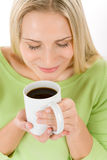 Portrait of happy blond woman enjoy coffee Stock Image