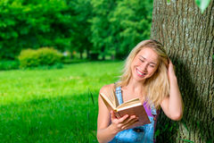 Portrait of happy blonde with a book Royalty Free Stock Photography
