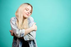 Portrait of happy blonde woman in jeans jacket stock photography