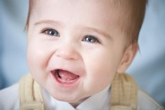 Portrait of happy blue-eyes baby Stock Images