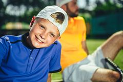 Cheerful child relaxing after training royalty free stock images