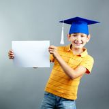 Schoolboy with blank paper Stock Photo