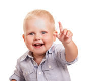 Portrait happy boy in bright shirt with raised hand isolated. Portrait of a happy boy in a bright shirt with a raised hand isolated on white background Royalty Free Stock Image