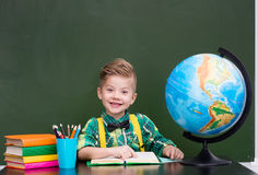 Portrait of a happy boy in classroom.  Stock Photo