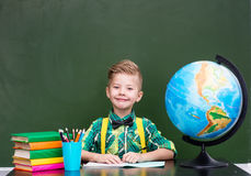 Portrait of a happy boy in classroom.  Stock Images