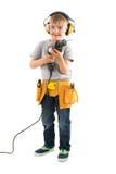 Portrait Of Happy Boy Holding Drilling Machine royalty free stock photo