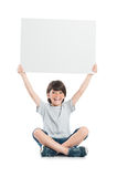 Portrait of happy boy holding sign Royalty Free Stock Photo