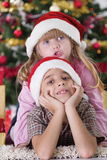 Portrait of happy boy laughing in his sister embrace on Christma Stock Images