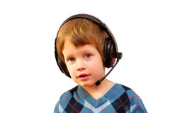 Portrait of happy boy listening to music with Royalty Free Stock Photography