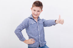 Portrait of happy boy showing thumb up gesture. Over white background Royalty Free Stock Photography