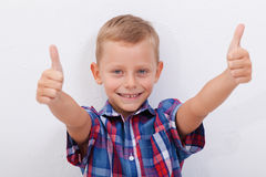 Portrait of happy boy showing thumbs up gesture. Over white background Royalty Free Stock Photo