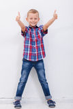 Portrait of happy boy showing thumbs up gesture. Over white background Royalty Free Stock Image
