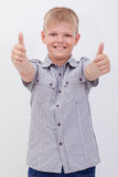 Portrait of happy boy showing thumbs up gesture Stock Photography