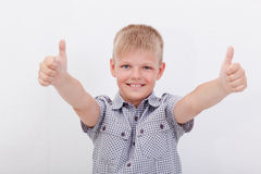 Portrait of happy boy showing thumbs up gesture. Over white background Royalty Free Stock Photos