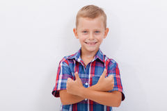Portrait of happy boy showing thumbs up gesture. Over white background Royalty Free Stock Photography
