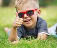 Portrait of happy boy showing thumbs up gesture. Portrait of smiling boy showing thumbs up gesture Royalty Free Stock Photo