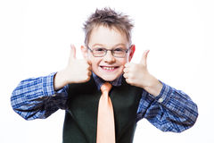 Portrait of happy boy showing thumbs up. Gesture on the white background Stock Photo