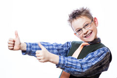 Portrait of happy boy showing thumbs up. Gesture on the white background Stock Image