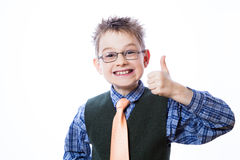 Portrait of happy boy showing thumbs up Stock Photos