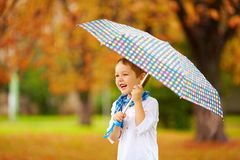 Portrait of happy boy with umbrella under the rain Royalty Free Stock Photo