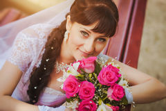 Portrait of happy bride with a bouquet in hands Stock Photo