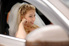 Portrait of the happy bride in a car Royalty Free Stock Photography