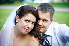 Portrait of happy bride and groom Stock Photos
