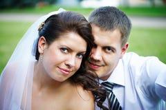 Portrait of happy bride and groom Stock Photos
