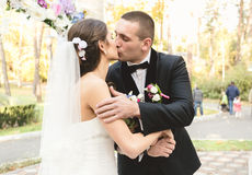 Portrait of happy bride and groom kissing first time at ceremony Stock Photography