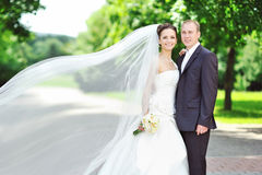Portrait of happy bride and groom in a park Royalty Free Stock Photo