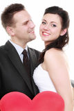 Portrait of happy bride and groom with red heart Royalty Free Stock Images
