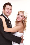 Portrait of happy bride and groom on white background Stock Images