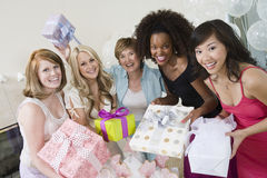 Portrait Of A Happy Bride With Her Friends And Mother stock photo