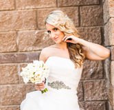 Portrait of a happy bride holding flowers Royalty Free Stock Photo