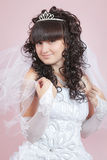Portrait of a happy bride on a pink background Stock Photography