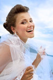 Portrait of Happy Bride. With a veil at the water view Stock Image