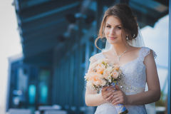 Portrait of happy bride with a wedding bouquet Royalty Free Stock Photos