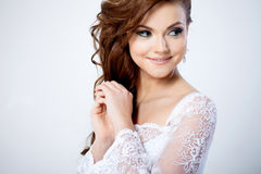 Portrait of happy bride in wedding dress, white. Beautiful smiling woman in a wedding dress Stock Images