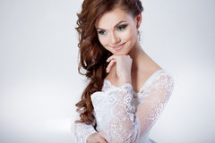 Portrait of happy bride in wedding dress, white. Beautiful smiling woman in a wedding dress Royalty Free Stock Image