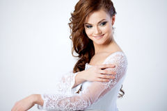 Portrait of happy bride in wedding dress, white. Beautiful smiling woman in a wedding dress Royalty Free Stock Photography