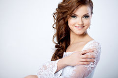 Portrait of happy bride in wedding dress, white. Beautiful smiling woman in a wedding dress Stock Photography