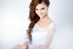 Portrait of happy bride in wedding dress, white. Beautiful smiling woman in a wedding dress Stock Image