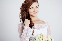 Portrait of happy bride in wedding dress, white. Beautiful smiling woman in a wedding dress Royalty Free Stock Images