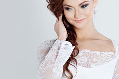 Portrait of happy bride in wedding dress, white. Beautiful smiling woman in a wedding dress Stock Photo