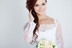 Portrait of happy bride in wedding dress, white. Beautiful smiling woman in a wedding dress Stock Photos