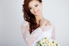 Portrait of happy bride in wedding dress, white. Beautiful smiling woman in a wedding dress Royalty Free Stock Photo