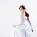 Portrait of happy bride in wedding dress, white Stock Photography